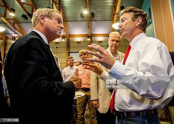 Sen Rand Paul right speaks Rep Joe Wilson during a South Carolina Republican barbecue event at the State Farmer's Market in West Columbia South...