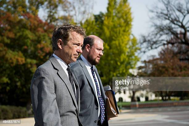 Sen Rand Paul RKy left walks across the East Plaza of the Capitol to the Senate for his filibuster of the the twoyear debt ceiling and budget...