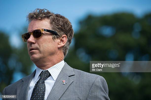 Sen. Rand Paul, R-Ky., listens at the House Triangle during the Coal Caucus' news conference on the EPA's recently proposed greenhouse gas standards...