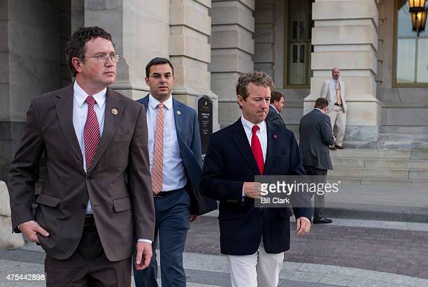 Sen Rand Paul RKy right leaves the US Capitol with Rep Thomas Massie RKy left and Rep Justin Amash RMich after Sen Paul spoke at length on the Senate...