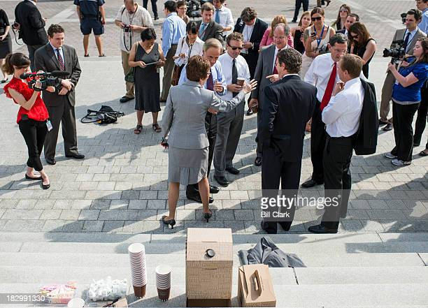 Sen Rand Paul RKy third from left invited members of the Senate and Congress for a bipartisan coffee on the steps of the Capitol on Thursday Oct 3...