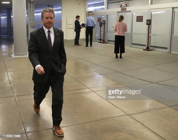 Sen Rand Paul walks through the US Capitol prior to the Senate voting to overturn the President's national emergency border declaration at the US...