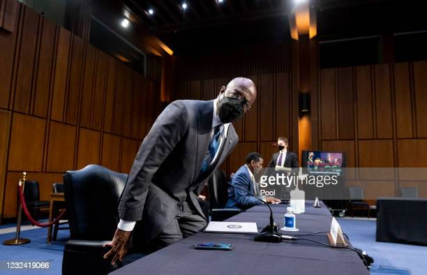 Sen. Raphael Warnock and Rep. Burgess Owens arrive for a Senate Judiciary Committee hearing on Capitol Hill April 20, 2021 in Washington, DC. The...