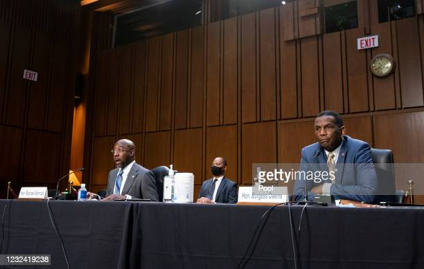 Sen. Raphael Warnock and Rep. Burgess Owens attend a Senate Judiciary Committee hearing on Capitol Hill April 20, 2021 in Washington, DC. The...