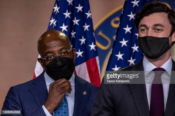 Sen. Raphael Warnock and Sen. Jon Ossoff during a press conference at Capitol Hill on March 10, 2021 in Washington, DC. The bill includes direct...
