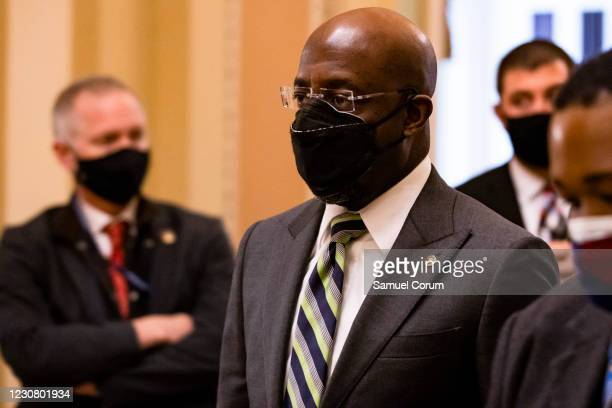 Sen. Raphael Warnock leaves the floor of the Senate on January 26, 2021 in Washington, DC. Today senators will be sworn in as the jury for the second...