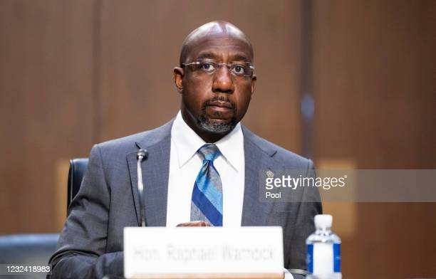 Sen. Raphael Warnock listens during a Senate Judiciary hearing on Capitol Hill April 20, 2021 in Washington, DC. The committee is hearing testimony...