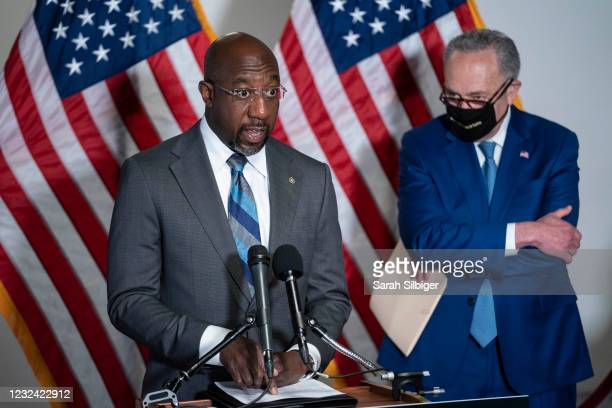 Sen. Raphael Warnock speaks as Senate Majority Leader Chuck Schumer listens during a news conference following the weekly Democrat policy luncheon on...