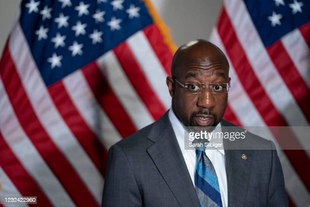 Sen. Raphael Warnock speaks during a news conference following the weekly Democrat policy luncheon on Capitol Hill on April 20, 2021 in Washington,...