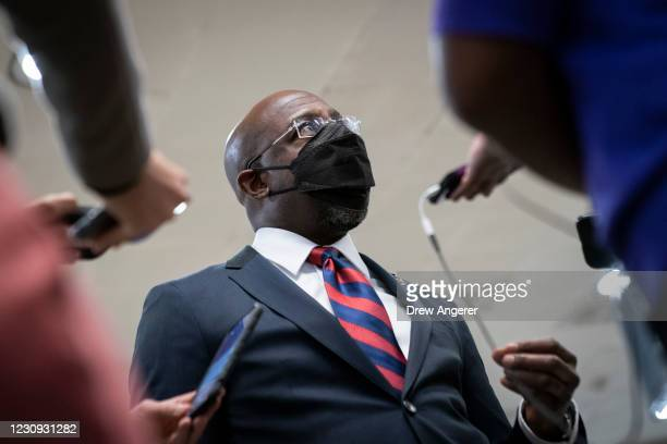 Sen. Raphael Warnock speaks to reporters in the Senate subway following a vote at the U.S. Capitol on February 2, 2021 in Washington, DC. On Tuesday...