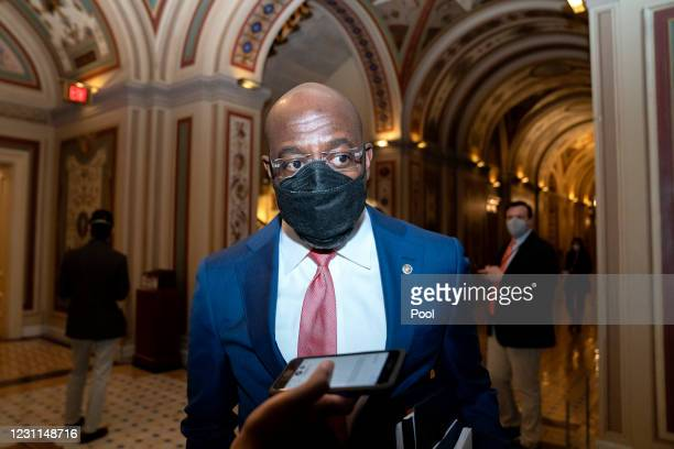 Sen. Raphael Warnock wears a protective mask while speaking to members of the media at the U.S. Capitol on February 13, 2021 in Washington, DC. The...