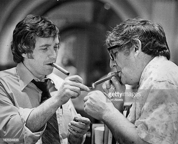 JUN 2 1977 JUN 3 1977 Sen Ray Kogovsek DRueblo Senate minority leader lights a cigar for Sen Martin Hatcher DGuniison as Senate begins discussions...