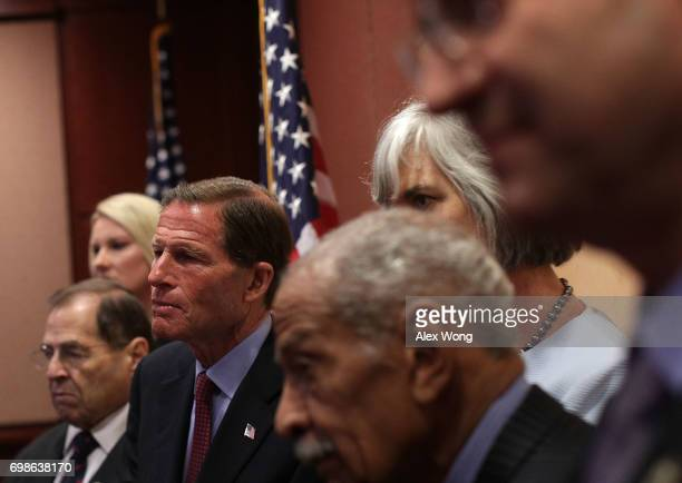S Sen Richard Blumenthal and other Democratic congressional members listen during a news conference June 20 2017 on Capitol Hill in Washington DC...