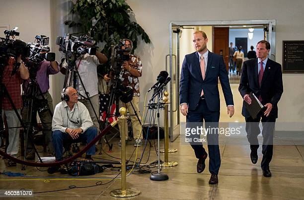 Sen Richard Blumenthal DConn right walks past the media stakeout as he leaves the Senate Armed Services Committee briefing in the Capitol on the...