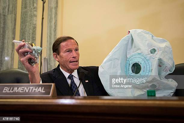 S Sen Richard Blumenthal holds up an airbag and inflator during a Senate Commerce Science and Transportation Committee hearing entitled ÒUpdate on...