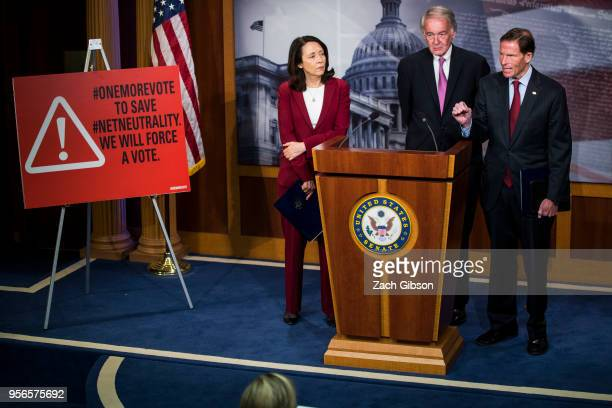 Sen Richard Blumenthal speaks during a news conference on a petition to force a vote on net neutrality on Capitol Hill in Washington DC Also pictured...