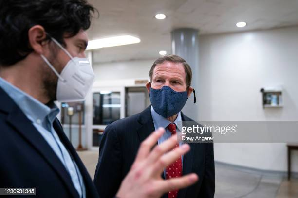 Sen. Richard Blumenthal speaks to a reporter in the Senate subway on his way to a vote at the U.S. Capitol on February 2, 2021 in Washington, DC. On...