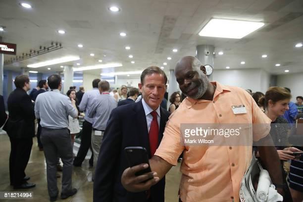 Sen Richard Blumenthal takes a selfie with a tourist as he walks through the Senate subway at the US Capitol on July 18 2017 in Washington DC Senate...