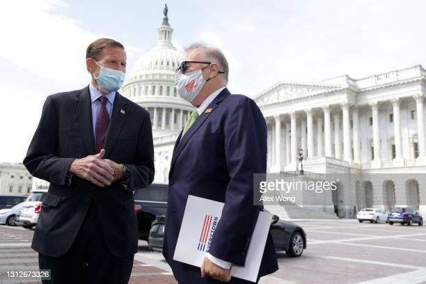 Sen. Richard Blumenthal talks to President of Everytown for Gun Safety John Feinblatt prior to an event on gun control outside the U.S. Capitol April...