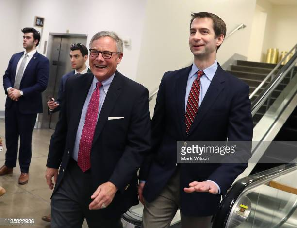Sen Richard Burr and Sen Tom Cotton walk through the US Capitol after the Senate voted to overturn the President's national emergency border...