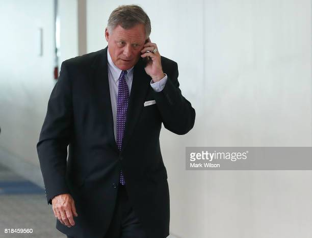 Sen Richard Burr Chairman of the Senate Select Committee on Intelligence talks on his phone as he walks to a closed committee meeting on Capitol Hill...