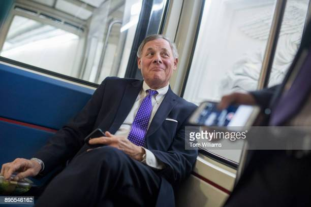 Sen Richard Burr RNC talks with reporters in the subway of the Capitol before the Senate Policy luncheons on December 19 2017