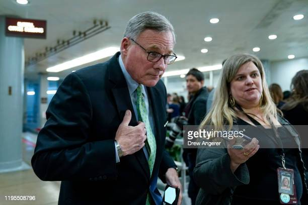 Sen Richard Burr speaks with a reporter as he walks through the Senate subway before the impeachment trial of President Donald Trump resumes at the...