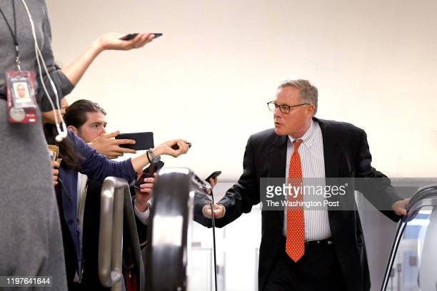 Sen Richard Burr talks with reporters as he heads to the Senate Chambers January 30 2020 in Washington DC Senators spend a second day asking both the...