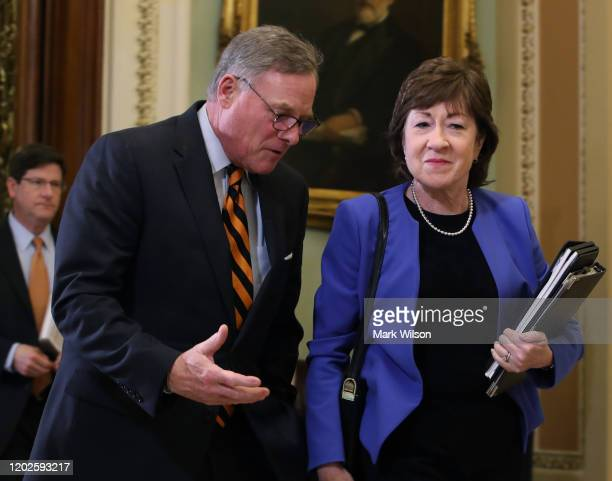 Sen Richard Burr walks with Sen Susan Collins out of the Senate Chamber after attending President Donald Trump's impeachment trial at the US Capitol...