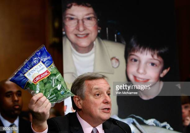 Sen. Richard Durbin holds up a package of bagged spinach as he testifies before the Senate Health, Education, Labor and Pensions Committee on...