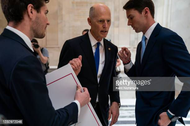 Sen. Rick Scott confers with staffers ahead of entering the Kennedy Caucus Room for the Senate Republican Policy luncheon at the Russell Senate...