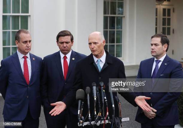 Sen Rick Scott speaks to the media while flanked by Rep Mario DiazBalart Florida Governor Ron DeSantis and Sen Marco Rubio after a meeting with...
