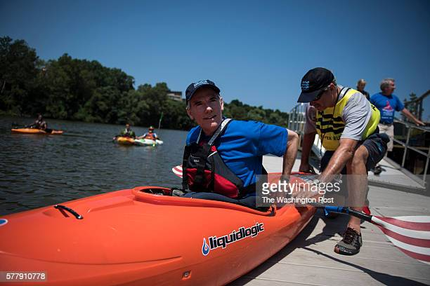 Sen Rob Portman gets int a kayak as he participates in a Paddling For Patriots event along the Cuyahoga River at Rivergate Park on the second day of...