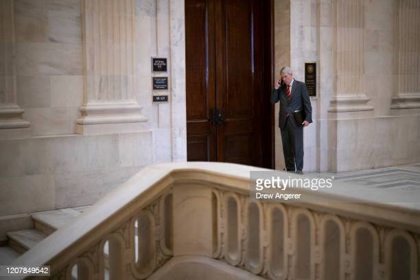 Sen. Rob Portman talks on the phone outside of a Senate GOP lunch meeting in the Russell Senate Office Building on Capitol Hill March 20, 2020 in...