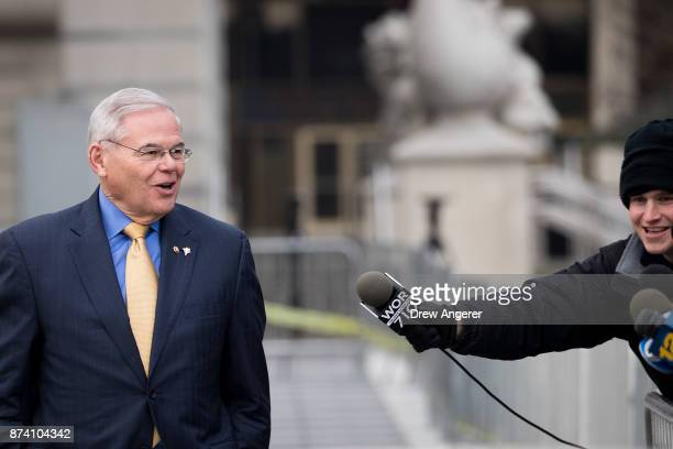 Sen Robert 'Bob' Menendez departs federal court November 14 2017 in Newark New Jersey The jury continues to deliberate in his corruption trial