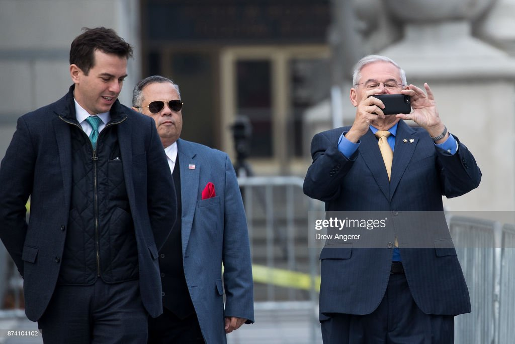 Sen. Robert 'Bob' Menendez (D-NJ) takes a photo of members of the media as he departs federal court, November 14, 2017 in Newark, New Jersey. The jury continues to deliberate in his corruption trial.