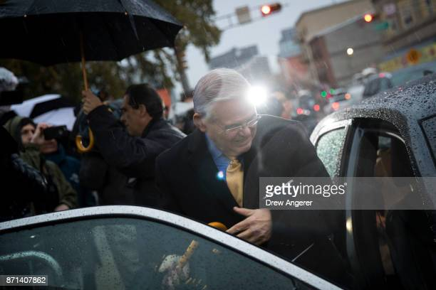 Sen Robert 'Bob' Menendez walks to his car as he leaves federal court after day two of jury deliberations in his corruption trial November 7 2017 in...