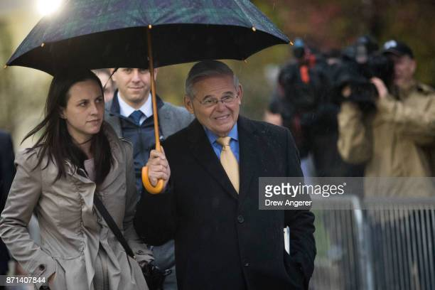 Sen Robert 'Bob' Menendez walks with his daughter Alicia as he leaves federal court after day two of jury deliberations in his corruption trial...
