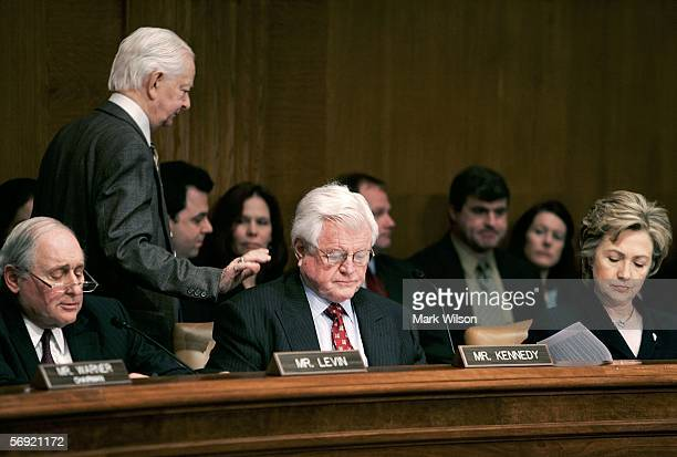 Sen Robert Byrd walks past Sen Carl Levin Sen Ted Kennedy and Sen Hillary Clinton while participating in a news briefing and questionandanswer...