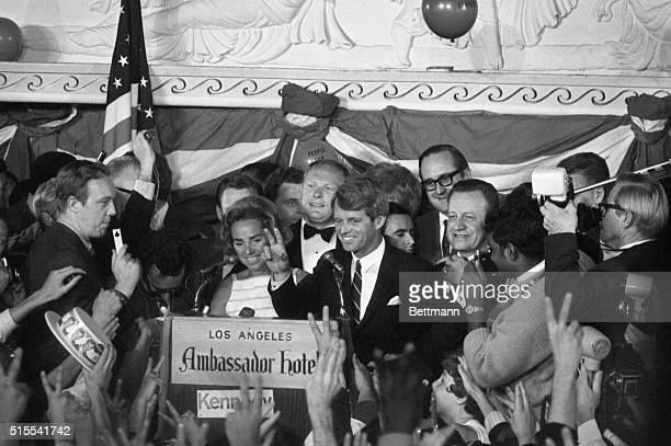 Sen Robert Francis Kennedy his wife Ethel standing behind him gives victory sign to huge crowd at the Ambassador Hotel June 5th prior to making...