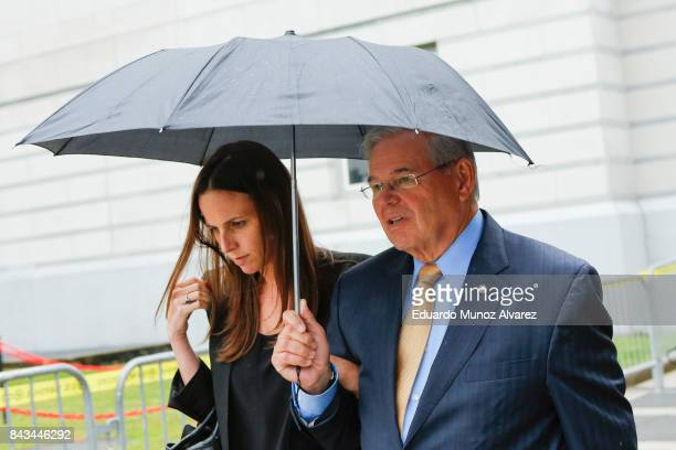 S Sen Robert Menendez accompanied by daughter Alicia Menendez leaves federal court during his trial on corruption charges on September 6 2017 in...