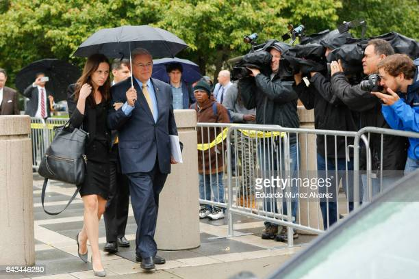 S Sen Robert Menendez accompanied by daughter Alicia Menendez walks to his car from federal court on the first day of his trial on corruption charges...