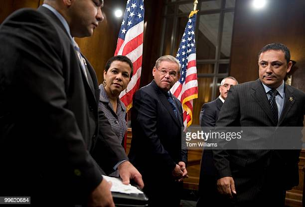 Sen. Robert Menendez, D-N.J., center, conducts a news conference with hispanic leaders including Hector Ramos, left, New Jersey State Police, Ramona...