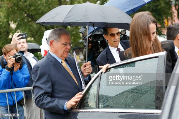 S Sen Robert Menendez enters his car after federal court with his daughter on the first day of his trial on corruption charges on September 6 2017 in...