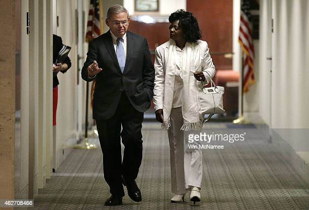 S Sen Robert Menendez escorts the leader of Cuba's Ladies in White activist group Berta Solar to the Senate Foreign Relations Western Hemisphere...