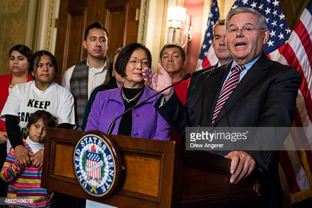 Sen Robert Menendez flanked by Sen Mazie Hirono and immigration activists and supporters speaks during a news conference to discuss US President...