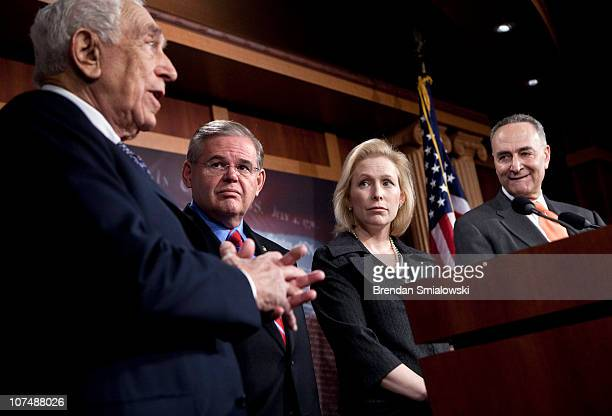Sen Robert Menendez Sen Kirsten Gillibrand and Sen Charles Schumer listen as Sen Frank Lautenberg speaks during a press conference on Capitol Hill...
