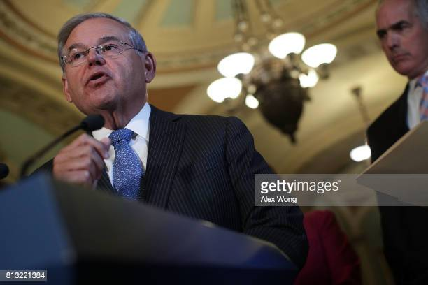 S Sen Robert Menendez speaks as Sen Robert Casey listens during a news briefing after the weekly Senate Democratic Policy Luncheon July 11 2017 at...