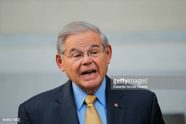 S Sen Robert Menendez speaks to the media as he arrives at federal court for his trial on corruption charges on September 6 2017 in Newark New Jersey...