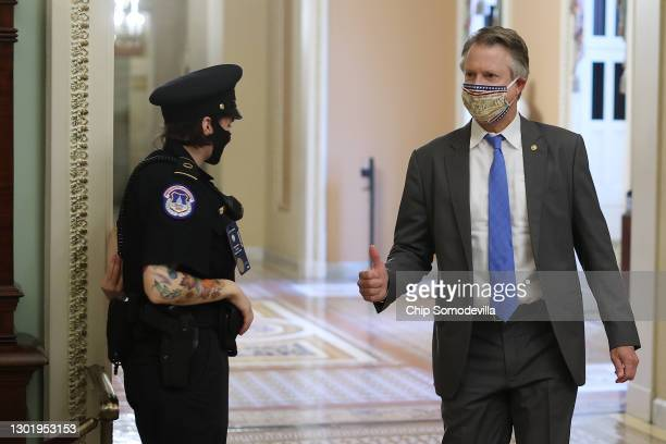 Sen. Roger Marshall gives a thumbs-up to a Capitol Police officer on his way to the Senate Chamber for the fifth day of former President Donald...